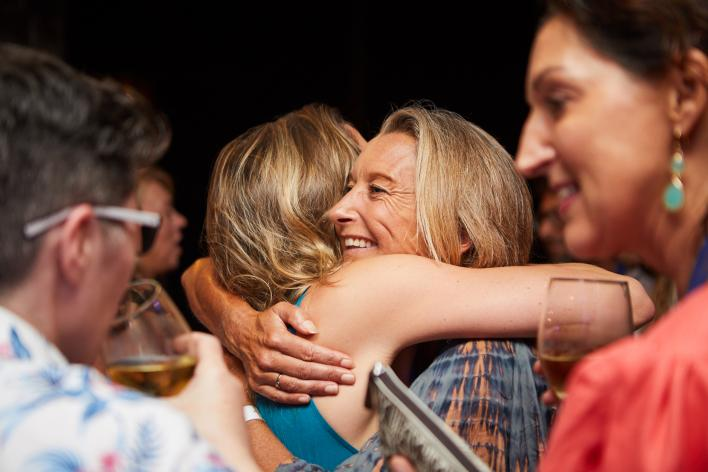 Layne Beachley hugging attendee